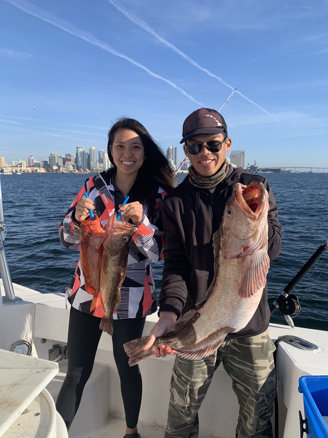 Couple holding caught fish