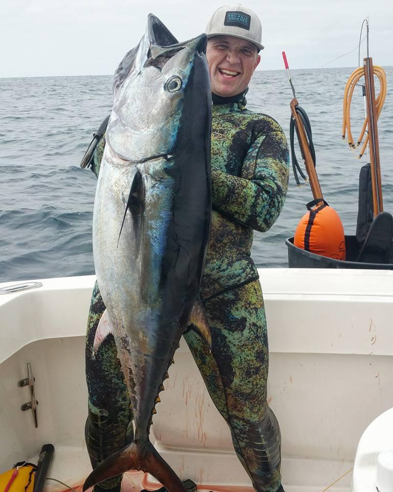 Captain Evan holding large fish